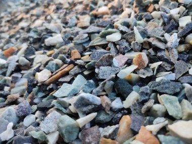 Stack of broken stones.Big pile of broken Rocks and Boulders.Pile stack of huge natural granite stone.Stack of Crushed Stones in quarry. Colorful pebble.