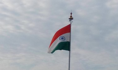 Picture of India country flag in a flagpole in front of chennai international airport as an integrity freedom independence symbol floating in the air with cloudy background