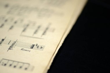 The page of the old musical notebook on a dark background