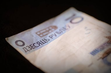 Outdated Belarusian ten rubles banknote on a dark background close up. Retro style