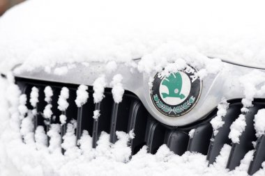Moscow, Russia - January 11, 2019: Skoda car covered with snow on a winter street
