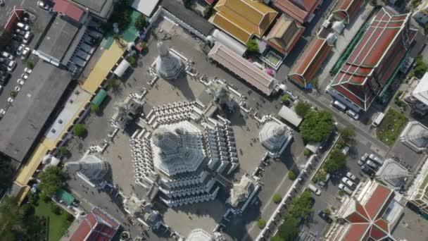 Aerial shot rising over Wat Arun Temple in Bangkok, Thailand