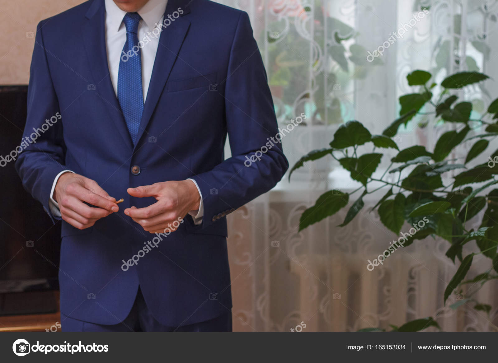 13fd1251de31 A businessman setting a tie straight, or a groom dressing for a wedding —  Photo by ...
