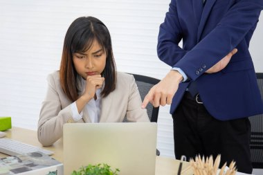 Asian female company staff sitting thinking of planning