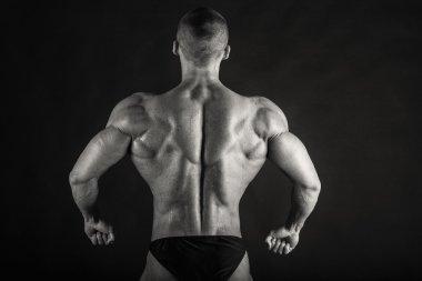Black and white photo of bodybuilder