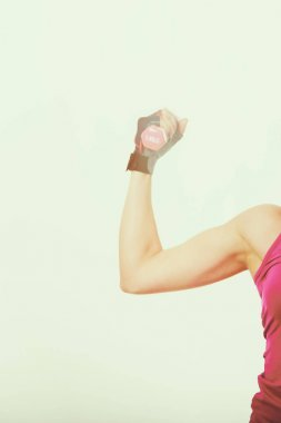 Muscular female body with sweat