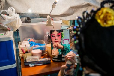 Teochew Opera. Artiste putting on makeup. Traditional heritage arts.