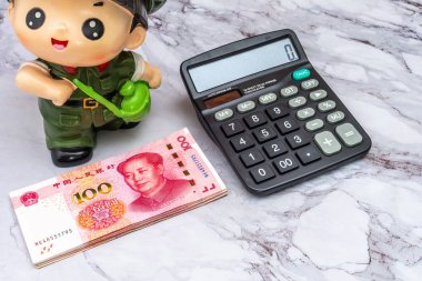 Finance Business concept. Pile of China Chinese Yuan RMB bank notes, and keyboard on table.