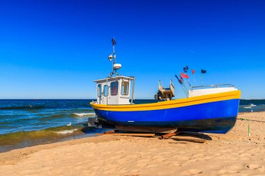 Vibrant fishing boats on the sandy beach of Baltic sea in Sopot