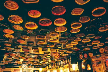 Delirium Cafe - Beer Brewers adorn the ceiling of the Delirium Cafe in Brussels - July 2013