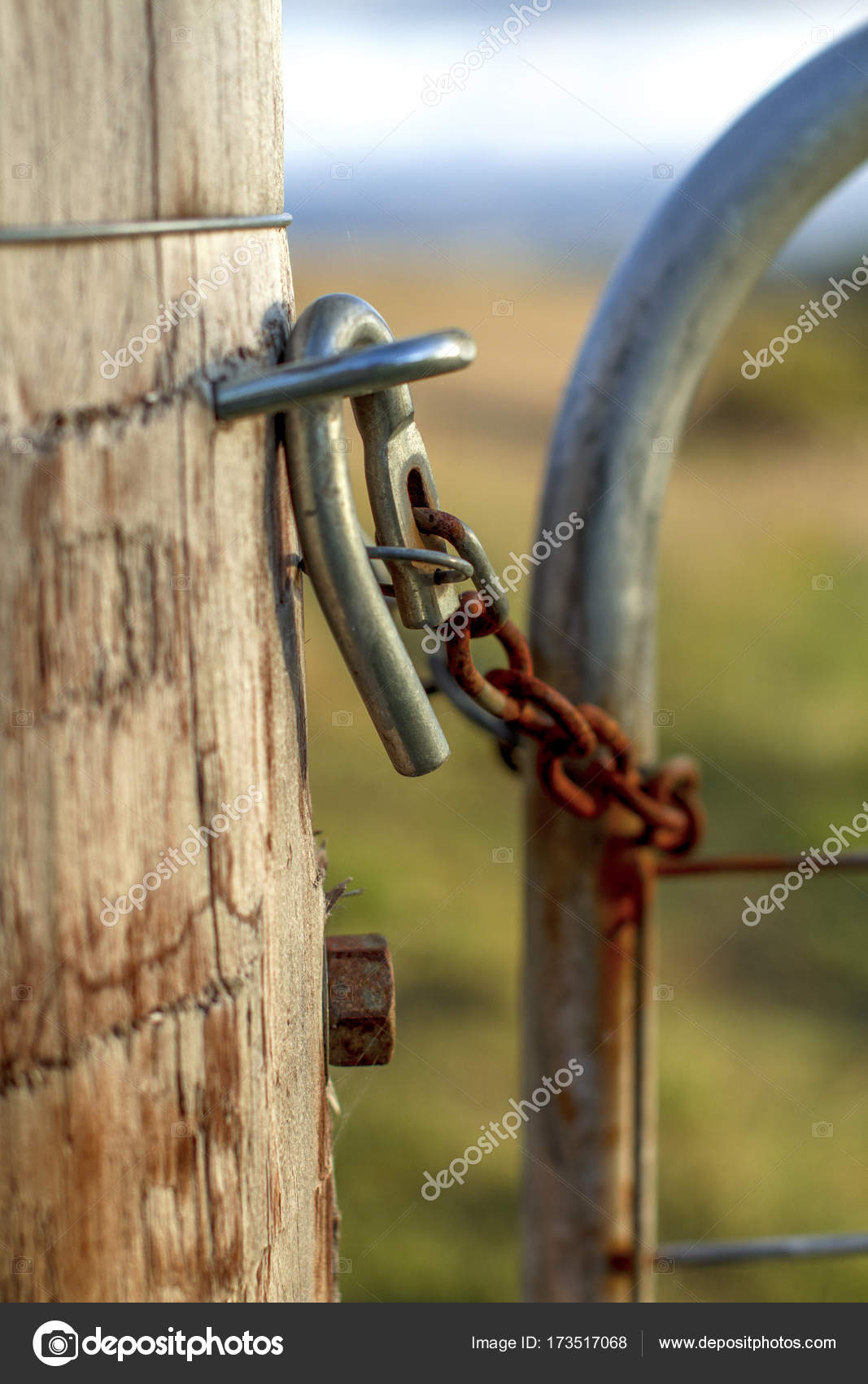 A rusty cattle lock fence — Stock Photo © Whitepointer #173517068