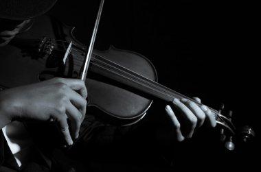 Close up Violin player in dark studio