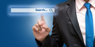 Businessman touching virtual searching bar