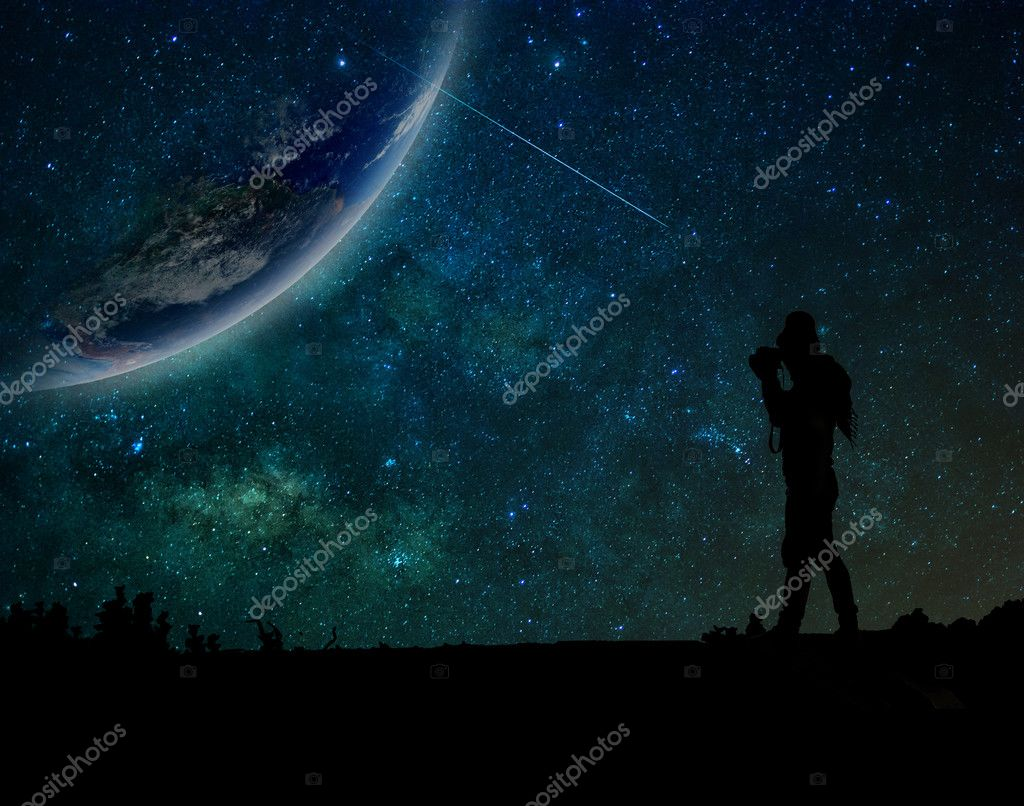 Silhouette of photographer taking photo of earth
