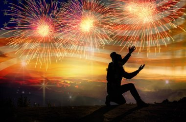 silhouette of  man  over the Multicolor Fireworks