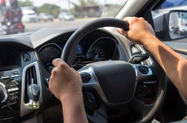 Closeup Hands driving a car