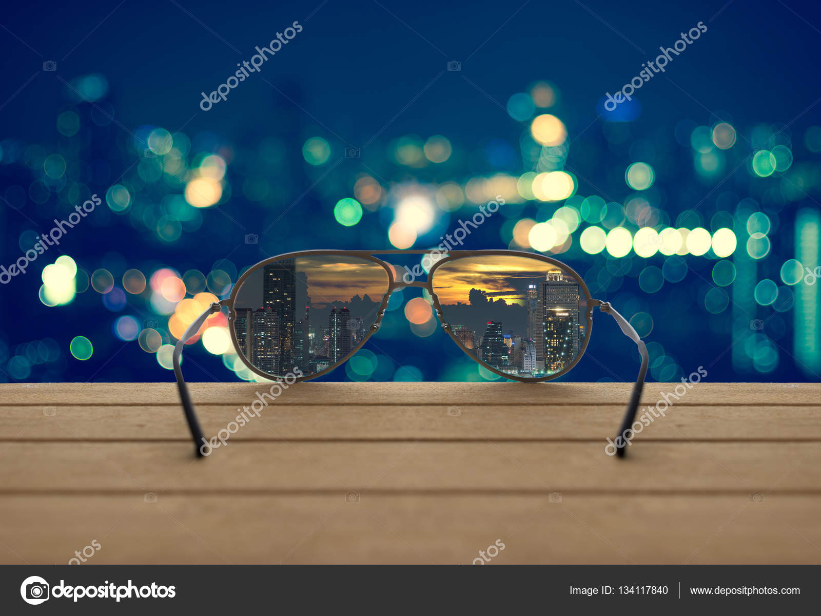 84e8b23973 Cityscape focused in glasses lenses on the wooden over the abstract photo  blurred of cityscape background
