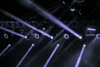 blue luminous rays from concert