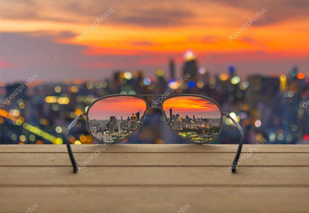Фотообои Cityscape focused in glasses lenses