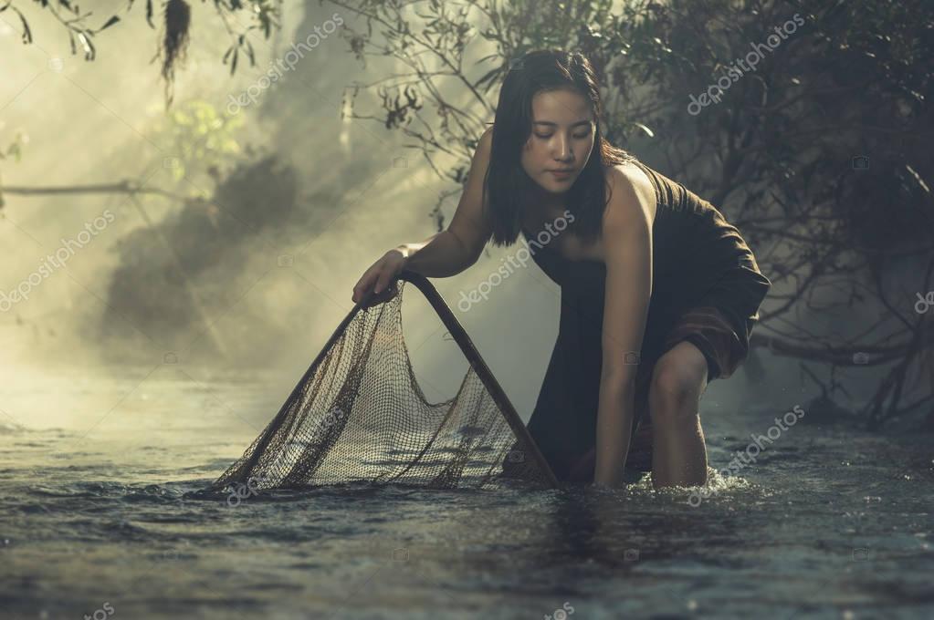 woman fishing at sunrise