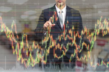 businessman pointing the stock graph