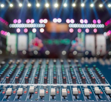 Audio mixer over the Stage Spotlight with blue luminous rays and Blurred Photo bokeh from light,musical concert and instrument concept stock vector