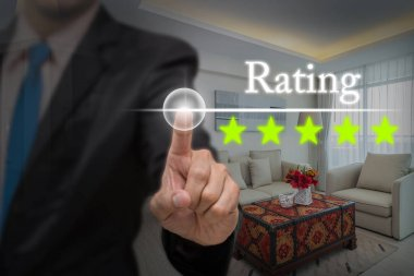Businessman pointing five star button