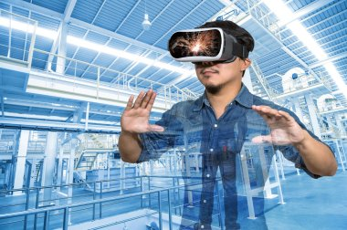 Double exposure of Asian man wearing virtual reality over the Factory equipment inside Industrial conveyor line transporting package, VR concept stock vector