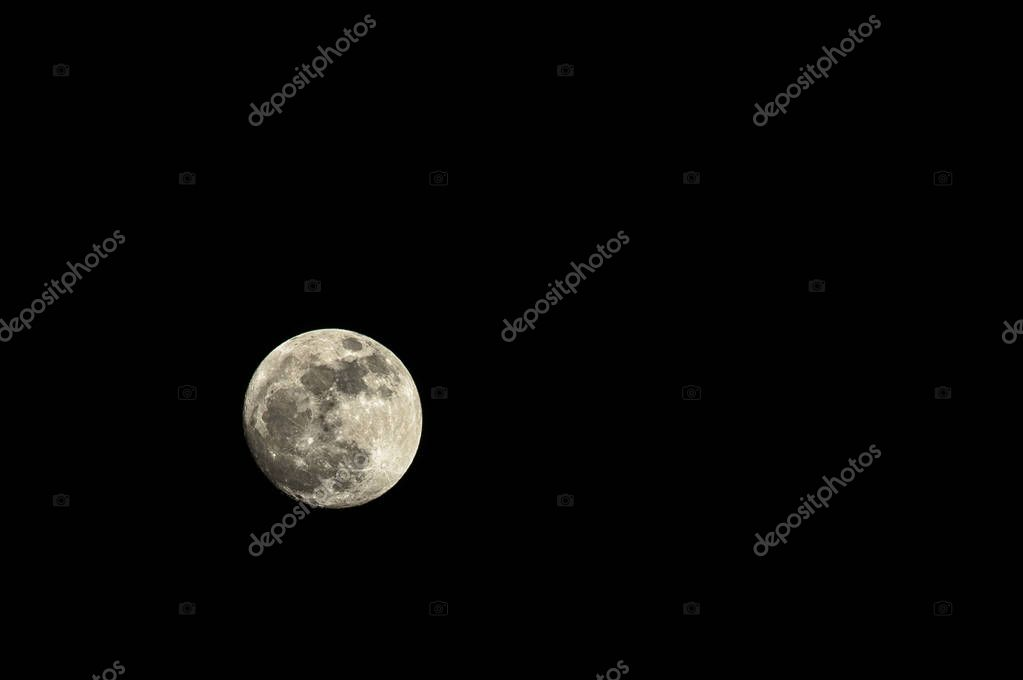 Super full moon on background