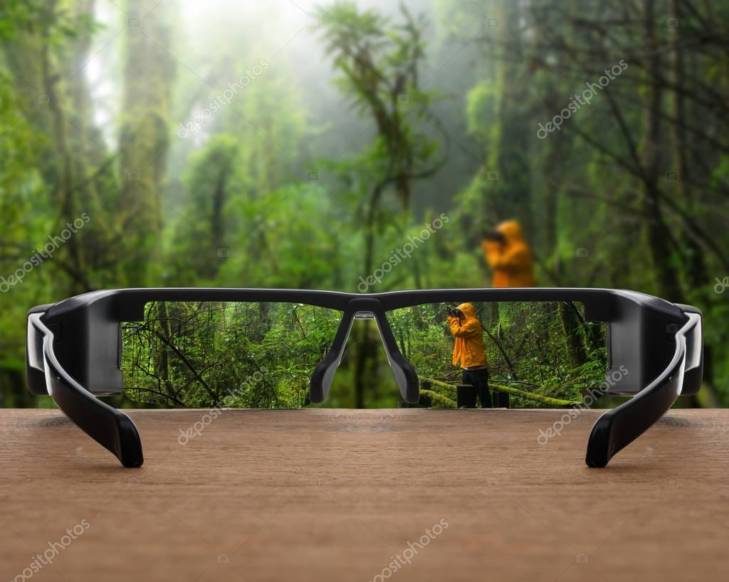 rain forest focused in glasses lenses