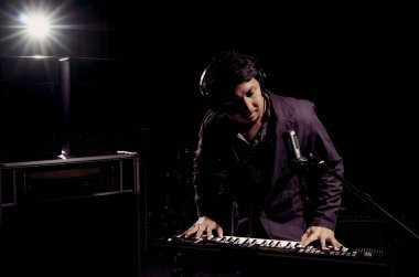 Musician playing keyboard with music instrument