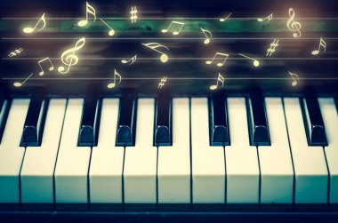 keyboard of piano with music notes