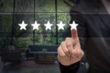 Businessman pointing five star symbol