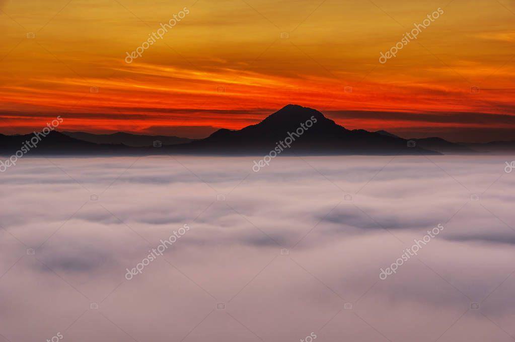 Misty Mountain with sun rays