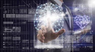Businessman touching the polygonal brain