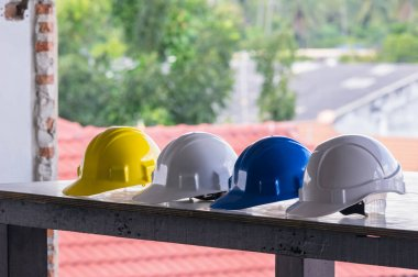 colorful safety hard hats on table
