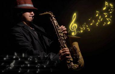 saxophone player in dark room