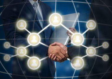 Business handshake with Social media symbol