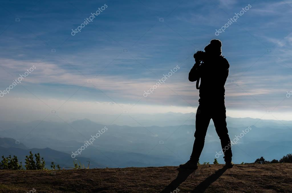 silhouette of photographer taking picture