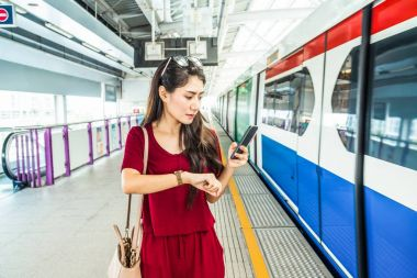 Asian woman passenger watching clock