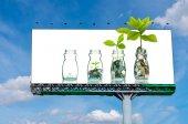 Billboard zobrazující mix mincí a semena