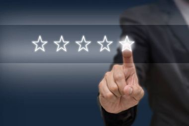 Businessman pointing five star symbol