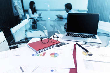 Business documents with laptop