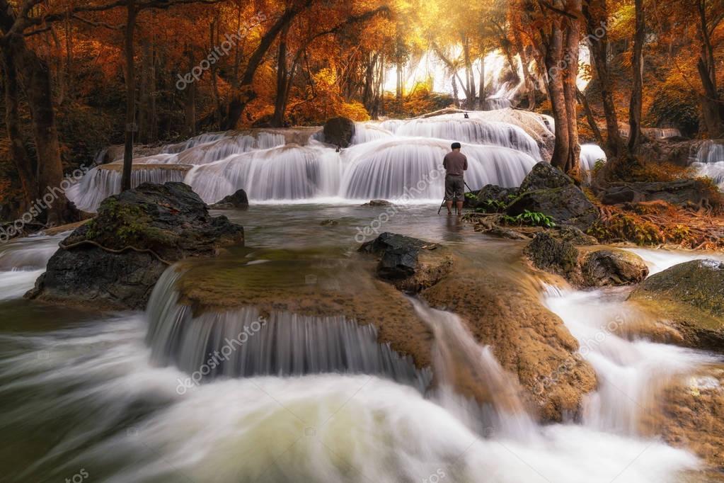 Photographer taking photo  of  waterfall