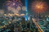 Top view of Bangkok Cityscape at night with Multicolor Firework Celebration, Mahanakhon