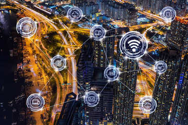 Wireless communication connecting of smart city Internet of Things Technology over Top view Scene of Hong Kong cityscape with traffic at night, Norway, business IOT concept