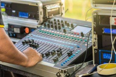Closeup hand prepare adjust the audio mixer, Musical concept