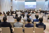 Fotografie Abstract blurred photo of conference hall or seminar room with attendee background, business and education concept