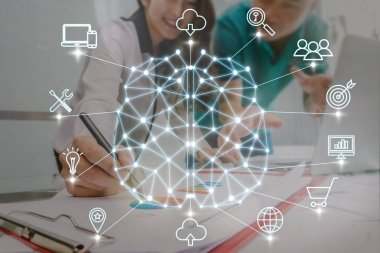 Polygonal brain shape of an artificial intelligence with various icon of smart city Internet of Things Technology over Business documents with laptop on the workplace, AI and business IOT concept