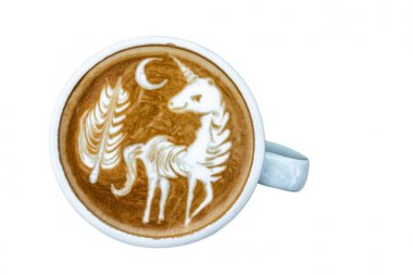 A Cup of coffee with latte art menu which show the unicorn and tree with moon on white background, drink and art concept, object isolate, include clipping path